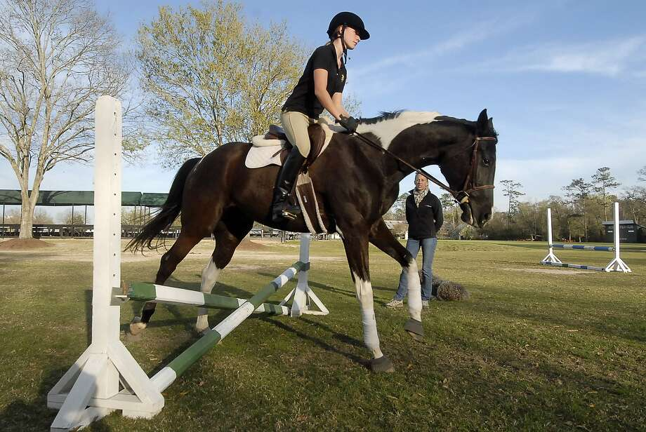 "Kendall Sill, a ninth-grader at Episcopal High School, jumps with ""Otto"" during a riding class hosted by Merrily Quincoces at the Houston Polo Club. Photo:  Tony Bullard 2013, Freelance Photographer / © Tony Bullard & the Houston Chronicle"