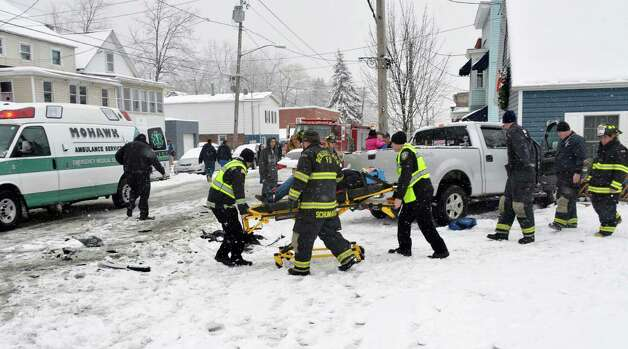 Emergency workers move an accident victim to a waiting ambulance after a 3-car accident on Broadway and Pine St. in Rensselaer Tuesday March 19, 2013.  (John Carl D'Annibale / Times Union) Photo: John Carl D'Annibale / 00021622A