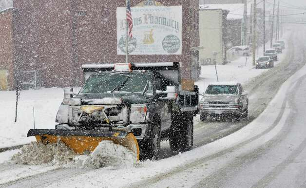 A city snow plow works to plow and salt Broadway in Rensselaer Tuesday March 19, 2013.  (John Carl D'Annibale / Times Union) Photo: John Carl D'Annibale / 00021622A