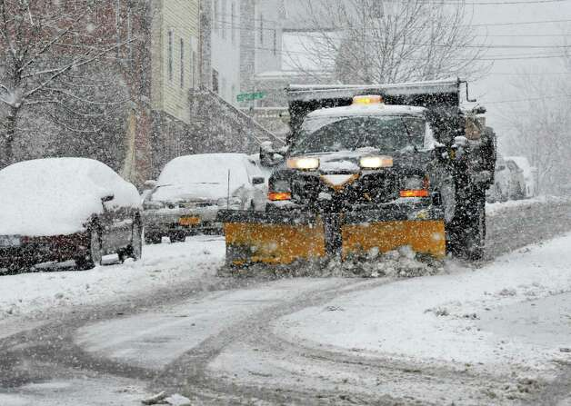 A city snow  plow works to plow and salt Partition Street in Rensselaer Tuesday March 19, 2013.  (John Carl D'Annibale / Times Union) Photo: John Carl D'Annibale / 00021622A