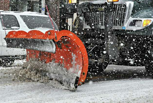 An Albany city snow plow on Broadway in Albany Tuesday March 19, 2013.  (John Carl D'Annibale / Times Union) Photo: John Carl D'Annibale / 00021622A