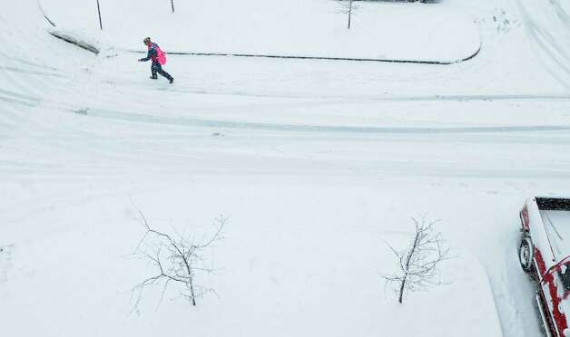 A student makes her way across a snow covered parking lot at Hudson Valley Community College on Tuesday, March 19, 2013 in Troy, NY.   (Paul Buckowski / Times Union) Photo: Paul Buckowski