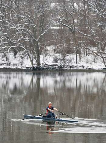 "Mike Macminn of Albany sculls in the Hudson River in Albany Tuesday March 19, 2013. Asked if he minded the snow he said ""it's not the snow but the water temperature that's a worry.""  (John Carl D'Annibale / Times Union) Photo: John Carl D'Annibale / 00021622A"