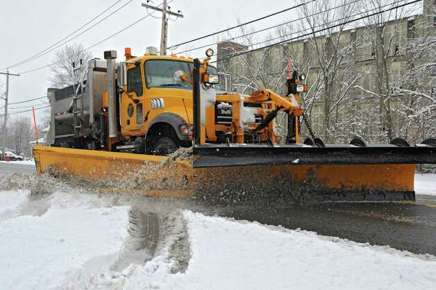 A snow plow clears a street on Tuesday, March 19, 2013 in Victory, N.Y. (Lori Van Buren / Times Union) Photo: Lori Van Buren