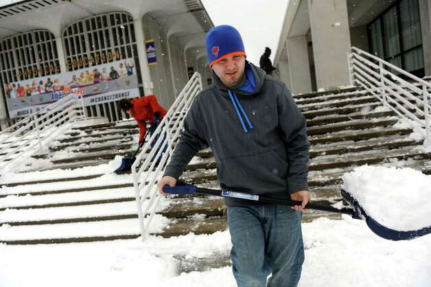 Maintenance worker Bruce Robinson helps clear the steps of snow on Tuesday, March 19, 2013, at the University at Albany in Albany , N.Y. (Cindy Schultz / Times Union) Photo: Cindy Schultz / 00021622A