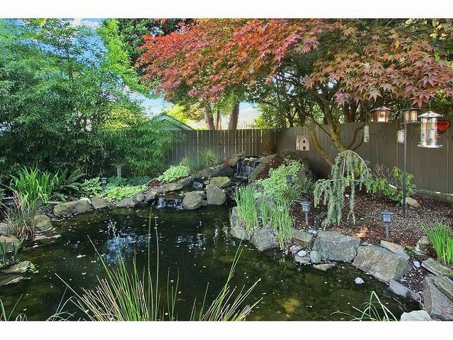 Pond with waterfall of 3215 44th Ave. W. The 2,720-square-foot house, built in 1952, has four bedrooms, 1.75 bathrooms, a rec room, a bonus room and a patio on a 5,394-square-foot lot. It's listed for $799,000, although a sale is pending. Photo: Courtesy Kelly Cash/Windermere Real Estate
