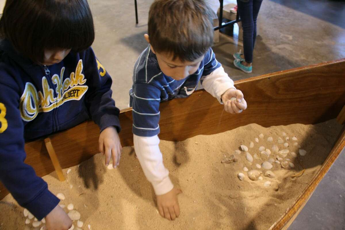 The fish are the draw, of course, but kids of all ages spent time digging for shells in this sand box at the Rockport Aquarium.
