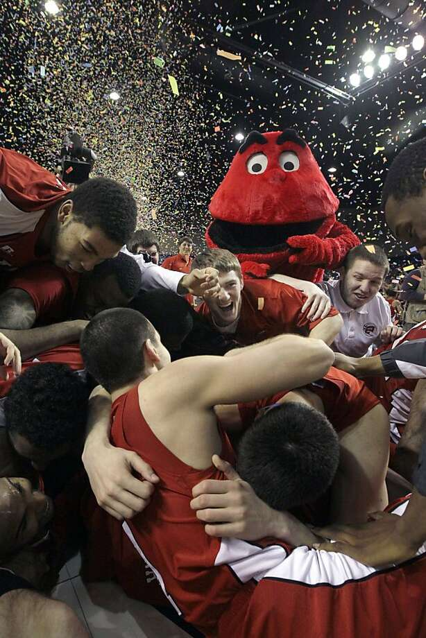 The last known photo of these players before they were consumed by the Hilltopper. Photo: Danny Johnston, Associated Press
