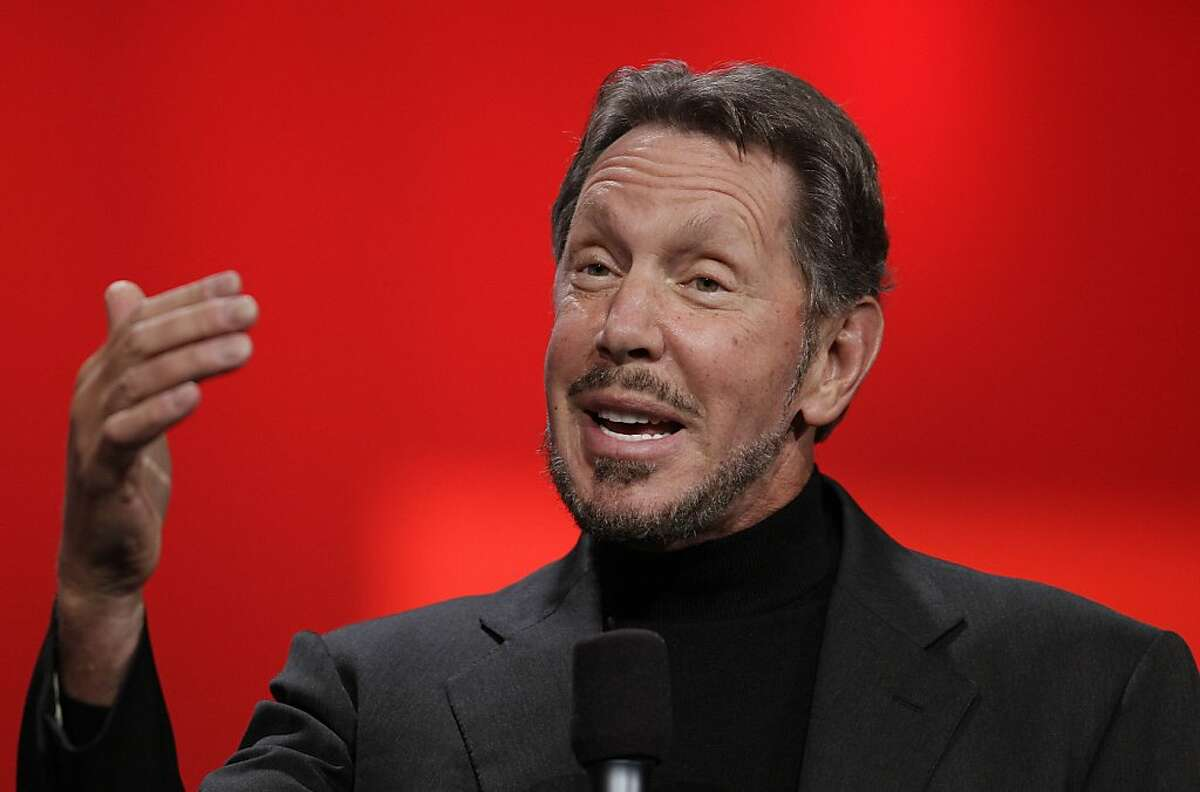 FILE - In this Oct. 2, 2012 file photo, Oracle CEO Larry Ellison gestures while giving a keynote address at Oracle OpenWorld in San Francisco. Ellison bought a small Hawaii airline Tuesday, Feb, 26, 2013, less than a year after he bought most of the Hawaiian island of Lanai. (AP Photo/Eric Risberg, File)