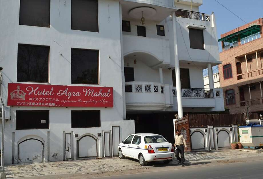 The facade of an Indian hotel, where a British tourist reportly jumped from in an attempt to escape a sexual assault, is pictured in Agra on March 19, 2013. A female British tourist was admitted to hospital after jumping through a hotel window March 19 in a bid to escape a sex assault in the Indian city of Agra, home to the Taj Mahal, police said.  The incident comes just days after a Swiss cyclist was gang-raped by a group of villagers while on a cycling trip with her husband that included a stop in the Taj Mahal city of Agra. AFP PHOTO/STRSTRDEL/AFP/Getty Images Photo: Strdel, AFP/Getty Images
