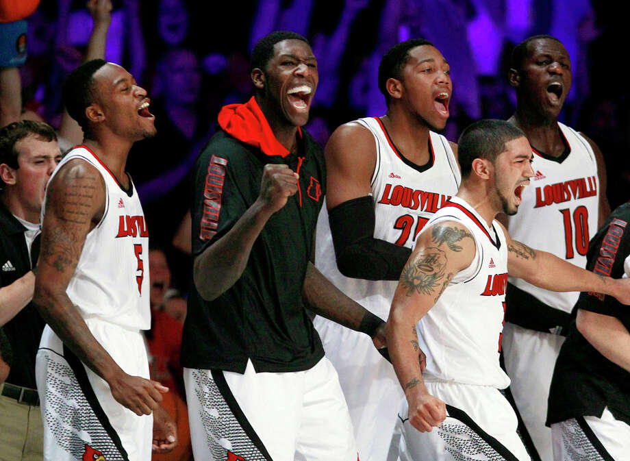 In this Nov. 23, 2012, file photo, Louisville's Kevin Ware (5), Montrezl Harrell (24), Peyton Siva, Zach Price (25) and Gorgui Dieng (10) react after a basket in the second half of an NCAA college basketball game against Missouri at the Battle 4 Atlantis tournament in Paradise Island, Bahamas. The Cardinals have shown that they are comfortable being front-runners in their season-long quest to go farther than last year's Final Four appearance. Now, they enter the NCAA tournament as the overall No 1 seed. Photo: AP / AP