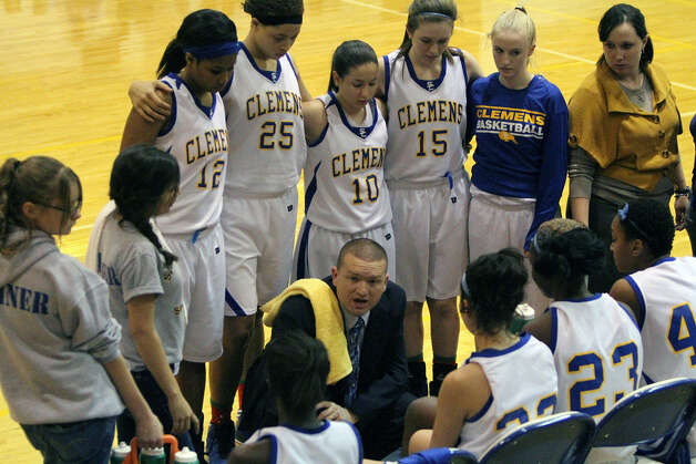 Lady Buffaloes coach John Ince rallies the troops during a game earlier this season. Five Clemens players were named to the All-District 27-4A team. Photo: NE Herald File Photo