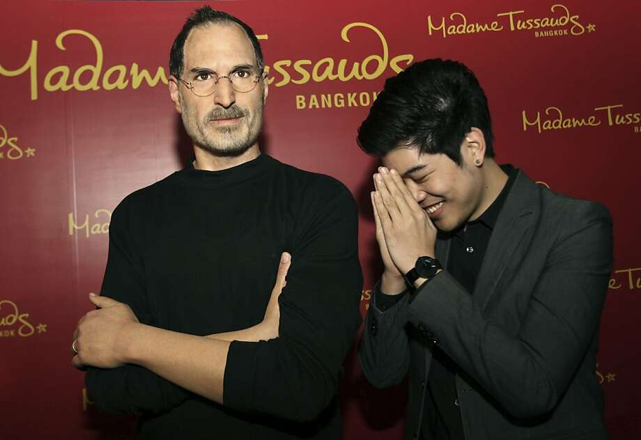 It's not Adam and Steve, it's Madame and Steve:A visitor gives a traditional Thai greeting to Steve Jobs at the Madame Tussauds wax museum in Bangkok. Photo: Sakchai Lalit, Associated Press
