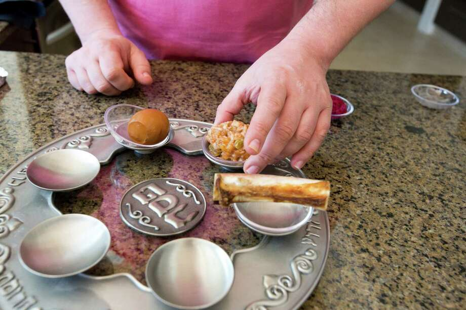 Ziggy Gruber of Kenny & Ziggy's deli prepares this spread. Photo: Eric Kayne, For The Houston Chronicle / © 2013 Eric Kayne