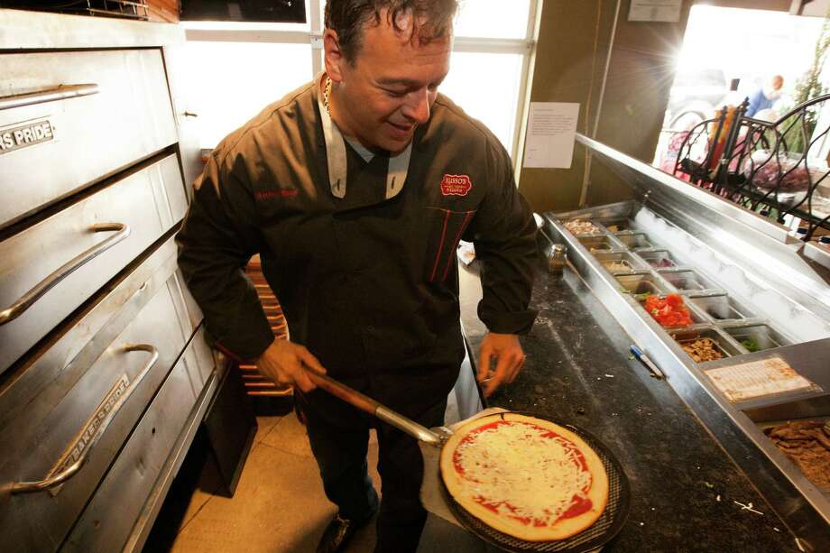 Russo's New York Pizzeria founder Anthony Russo prepares gluten free pizzas. Photo: J. Patric Schneider, For The Chronicle / © 2013 Houston Chronicle