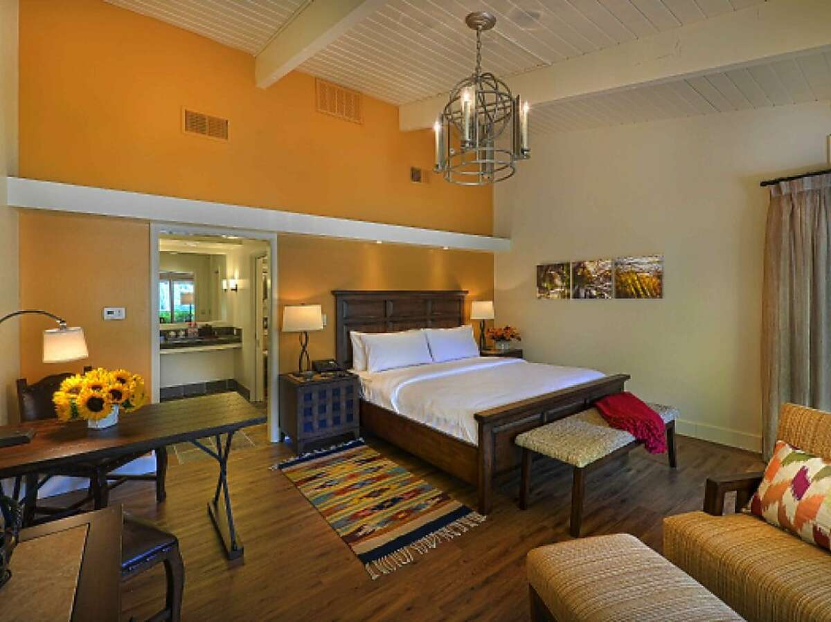 The 93 guest room bungalows of Quail Lodge, reopening March 26, feature a lighter palette and more contemporary California decor.