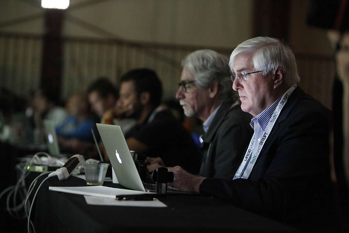 Ron Conway (right), SV Angel works on a laptop while listening to speakers at TechCrunch Disrupt SF 2012 at The Concourse at San Francisco Design Center on Tuesday, September 11, 2012 in San Francisco, Calif.
