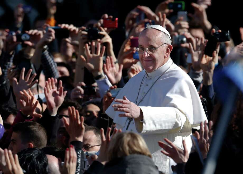 Pope Francis waves as he arrives in St. Peter's Square for his inauguration Mass at the Vatican, Tuesday, March 19, 2013. (AP Photo/Michael Sohn) Photo: Michael Sohn, STF / AP