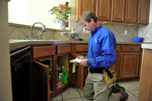 Mike Krumel looks over his notes while inspecting the kitchen of a home in Helotes. Krumel, who had a long career as a manufacturers representative for homebuilding products before retiring, now owns a Pillar to Post franchise that specialize in home inspections. Photo: Robin Jerstad