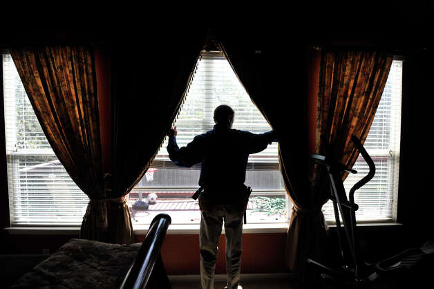 Mike Krumel inspects the windows of a home in Helotes. Krumel,  who had a long career as a manufacturers representative for homebuilding products before retiring, now owns a Pillar to Post franchise that specialize in home inspections. Photo: Robin Jerstad