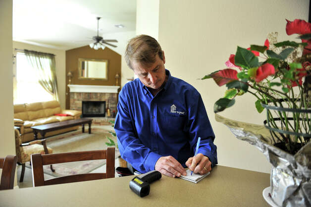 Mike Krumel writes his notes after inspecting a home in Helotes. Krumel, who had a long career as a manufacturers representative for homebuilding products before retiring, now owns a Pillar to Post franchise that specialize in home inspections. Photo: Robin Jerstad