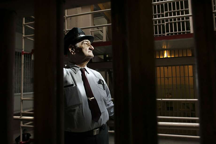 "Jim Albright, the last Alcatraz prison guard to escort inmates off the island, revisits the main cellblock. Unlike the convicts, he was sorry to leave. ""I loved it,"" he says of the four years he spent on the island. Photo: Michael Macor, The Chronicle"