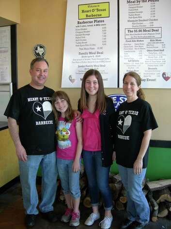 Heart O' Texas Barbecue owners Rob and Laurel Baumberger (with daughters Julie and Lindsay) prepare for Rob's deployment to Saudi Arabia. Photo: San Antonio Express-News