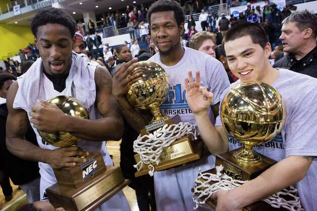 LIU Brooklyn's Jamal Olasewere ,left,  Booker Hucks,center, and  Jason Brickman, right,  pose for a photograph as they celebrate their third consecutive NEC trophy following their NCAA Northeast Conference championship game against Mount St. Mary's, Tuesday, March 12, 2013, in New York. LIU Brooklyn defeated Mount St. Mary's, 91-70. (AP Photo/John Minchillo) Photo: John Minchillo, Associated Press / FR170537 AP