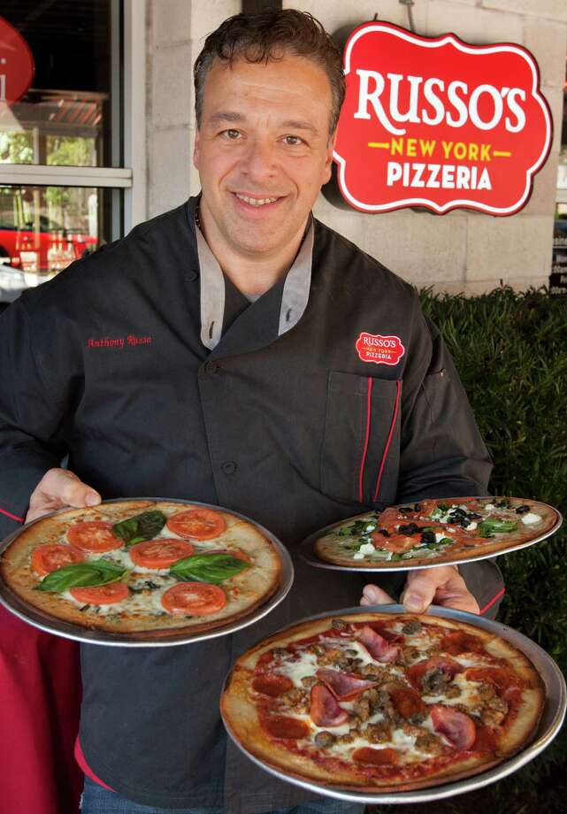 Russo's New York Pizzeria founder Anthony Russo shows off his pizza. Photo: J. Patric Schneider, Freelance / © 2013 Houston Chronicle