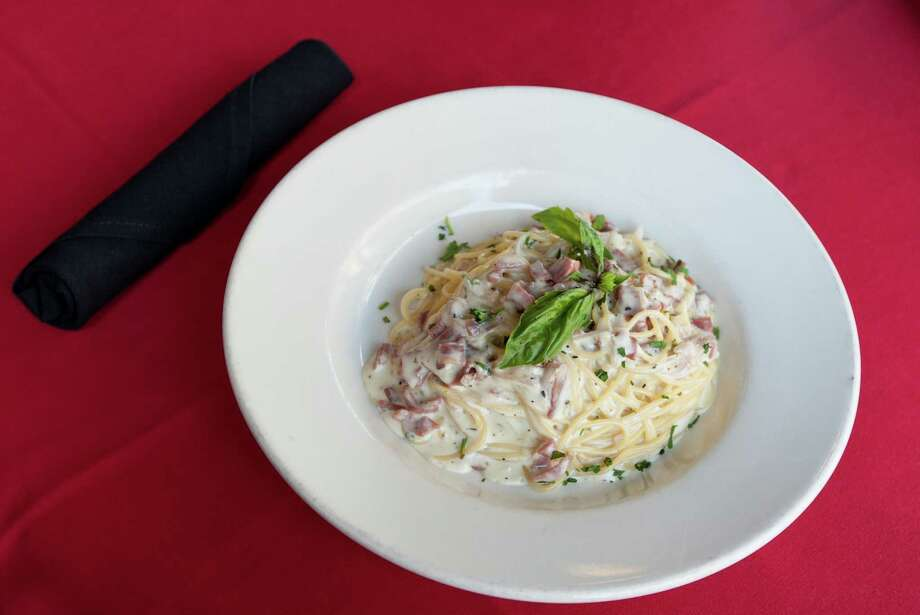 The gluten free dish has prosciutto, onions, fresh garlic, with romano cream sauce. Photo: J. Patric Schneider, Freelance / © 2013 Houston Chronicle