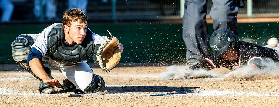 O'Connor's Justin Garcia waits for a throw to the plate as Churchill's Reed Hauser slides face first into home Friday during the sixth inning at Wolff Stadium. Photo: Marvin Pfeiffer / Northwest Weekly
