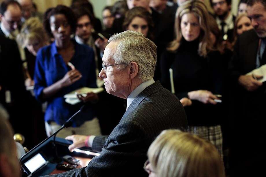 Senate Majority Leader Harry Reid, D-Nev., discusses his decision not to include bans on assault weapons and high-capacity magazines in legislation. Photo: T.J. Kirkpatrick, Getty Images