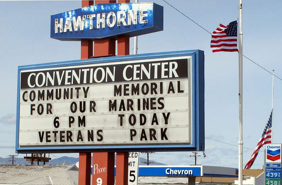 A sign at the convention center in Hawthorne, Nev., announces a memorial service for the Marines killed in an accident at the Hawthorne Army Depot. Photo: Scott Sonner, Associated Press