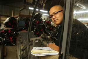 Army veteran Hien Manh Tran operates a forklift at Anvil Builders, a San Francisco firm he founded.