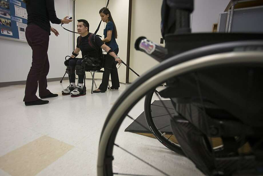 Spinal patient Robert Woo, 45, is among those trying out an Ekso Bionics exoskeleton. Photo: Scott Eells, Bloomberg
