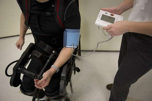Robert Woo gets his blood pressure taken while wearing an Ekso Bionics exoskeleton at Mount Sinai Medical Center. Photo: Scott Eells, Bloomberg
