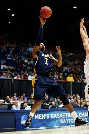 Adrian Powell #1 of the North Carolina A&T Aggies drives for a shot attempt in the first half against the Liberty Flames during the first round of the 2013 NCAA Men's Basketball Tournament. Photo: Gregory Shamus, Getty Images / 2013 Getty Images