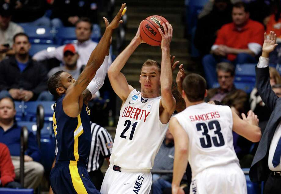 Joel Vander Pol #21 of the Liberty Flames looks to pass the ball in the first half. Photo: Gregory Shamus, Getty Images / 2013 Getty Images