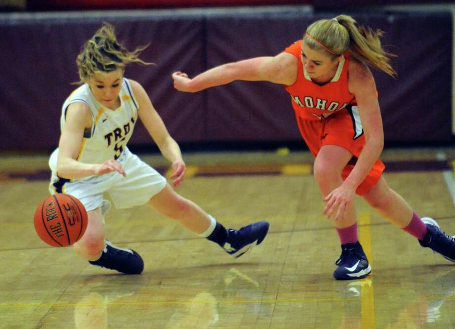 Troy's Brayleigh Hanlon steals the ball from Mohonasen's Kelsey Cowell during their Class A Section II girl's basketball semifinal on Tuesday Feb. 26, 2013 in Colonie, N.Y. (Michael P. Farrell/Times Union) Photo: Michael P. Farrell / 00021313A