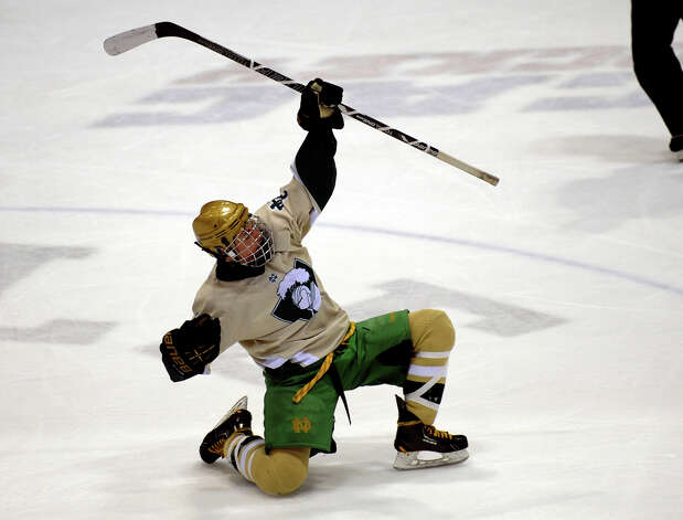 Notre Dame of West Haven's #8 William Vizzo celebrates a goal against Fairfield Prep, during CIAC Division I boys hockey final action at Ingalls Rink in New Haven, Conn. on March 19, 2013. Photo: Christian Abraham / Connecticut Post