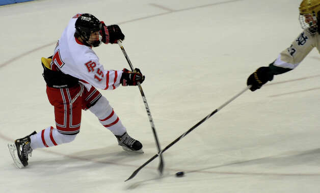 Fairfield Prep's #15 Kenneth Kochiss hits a slap shot, during CIAC Division I boys hockey final action against Notre Dame of West Haven at Ingalls Rink in New Haven, Conn. on March 19, 2013. Photo: Christian Abraham / Connecticut Post