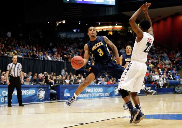 Jeremy Underwood #3 of the North Carolina A&T Aggies drives to the basket in the first half against Tavares Speaks #22 of the Liberty Flames during the first round of the 2013 NCAA Men's Basketball Tournament at University of Dayton Arena on March 19, 2013 in Dayton, Ohio. Photo: Gregory Shamus, Getty Images / 2013 Getty Images