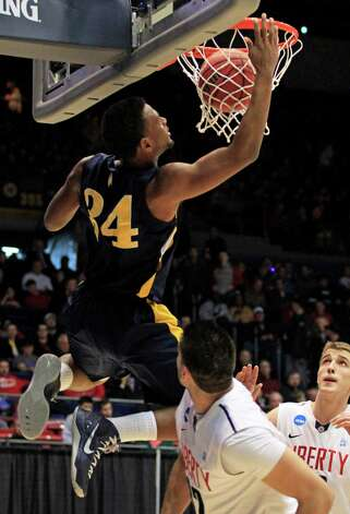 North Carolina A&T forward Bruce Beckford (34) dunks against Liberty forward JR Coronado in the first half. Photo: Skip Peterson, Associated Press / FR23879 AP