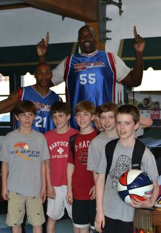 Saxe Middle School students hang out with members of the Harlem Rockets team for a meet and greet at the Outback. Harlem Rockets team will return to New Canaan Tuesday, March 26, to face the New Canaan Public Schools faculty again at 7 p.m. at New Canaan High School. Photo: Contributed Photo