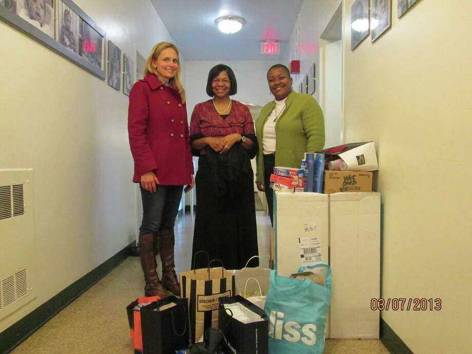 Robin Biasotti, Young Women's League of New Canaan Community Concerns liaison; Sarah Lewis, office manager of Malta House; Lucy Freeman, executive director of Malta House. YWL members recently donated more than 400 personal care products to the ladies of Malta House in Norwalk. Photo: Contributed Photo