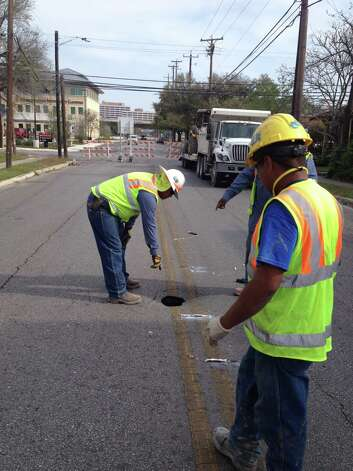 A sinkhole at 1207 McCullough Ave. is causing the closure of a half block for at least a day. Photo: Michelle Casady/Express-News