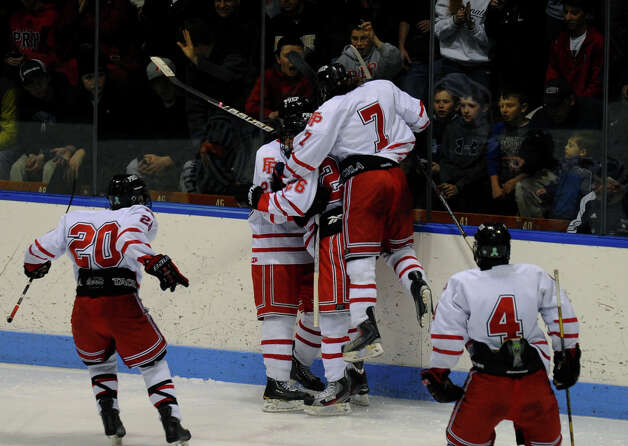 Fairfield Prep celebrates a goal by #25 Michael Ventricelli, during CIAC Division I boys hockey final action at Ingalls Rink in New Haven, Conn. on March 19, 2013. Ventricelli was assisted by teammate Tim Edmonds. Photo: Christian Abraham / Connecticut Post