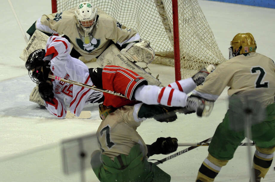 Notre Dame of West Haven's #17 Jesse Ruocco upends Fairfield Prep's #26 Matt McKinney, during CIAC Division I boys hockey final action at Ingalls Rink in New Haven, Conn. on March 19, 2013. Photo: Christian Abraham / Connecticut Post