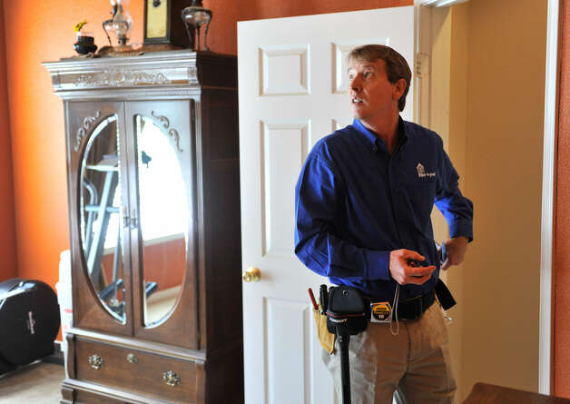 Michael Krumel inspects a home in Helotes. Krumel, 50, who had a long career as a manufacturer's representative for home building products before retiring, now owns a Pillar to Post franchise that specializes in home inspections. Photo: Robin Jerstad / For The San Antonio Express-News