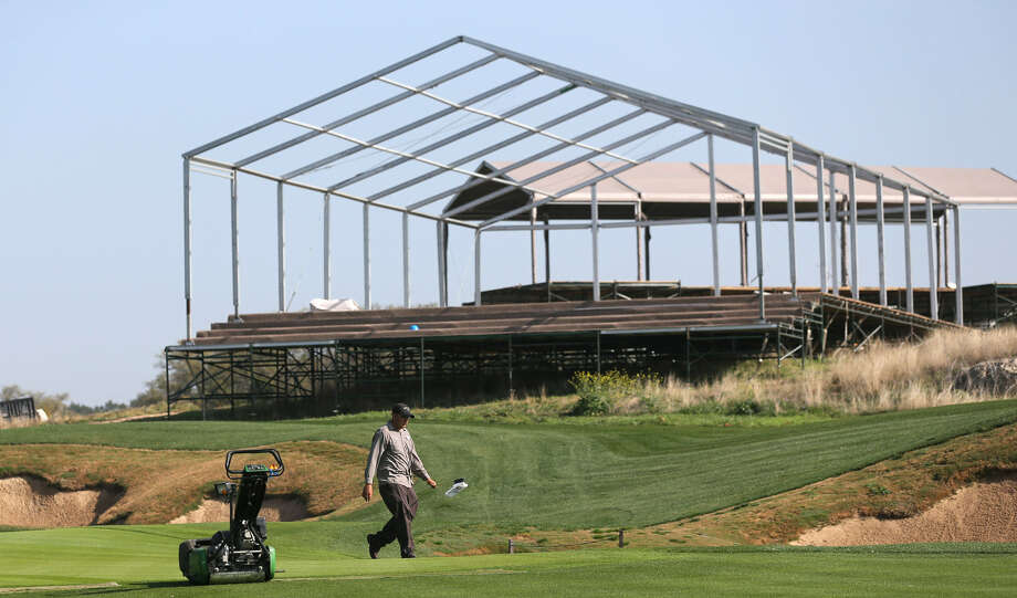 Bleachers and pavilions are under construction on the 15th green of the AT&T Oaks Course at TPC San Antonio. The Valero Texas Open hopes to enhance the fans' experience this year. Photo: Jerry Lara / San Antonio Express-News